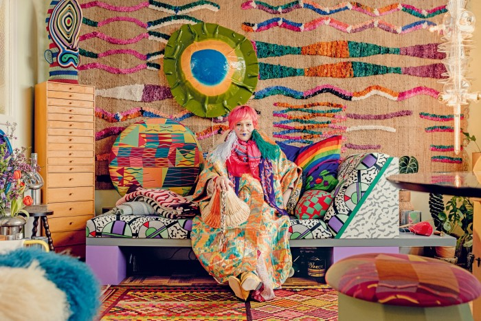 Wood on her sofa byMemphis members Nathalie du Pasquier and George Sowden – on the left, on the drawers, is aBertjan Pot mask, on the wall are her textile for Moroso and a Gaetano Pesce lamp, and to the far right is her Totem lamp for Nilufar Gallery