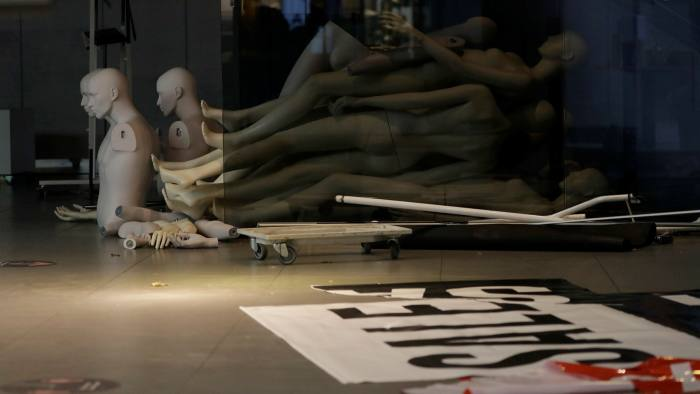 Mannequins left on the floor of a closed branch of Topshop on Oxford Street in London, England, on February 1