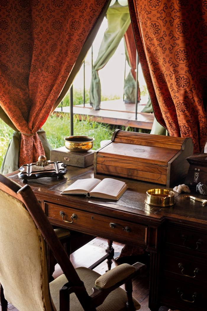 An antique writing desk in the main area at Jack'sCamp