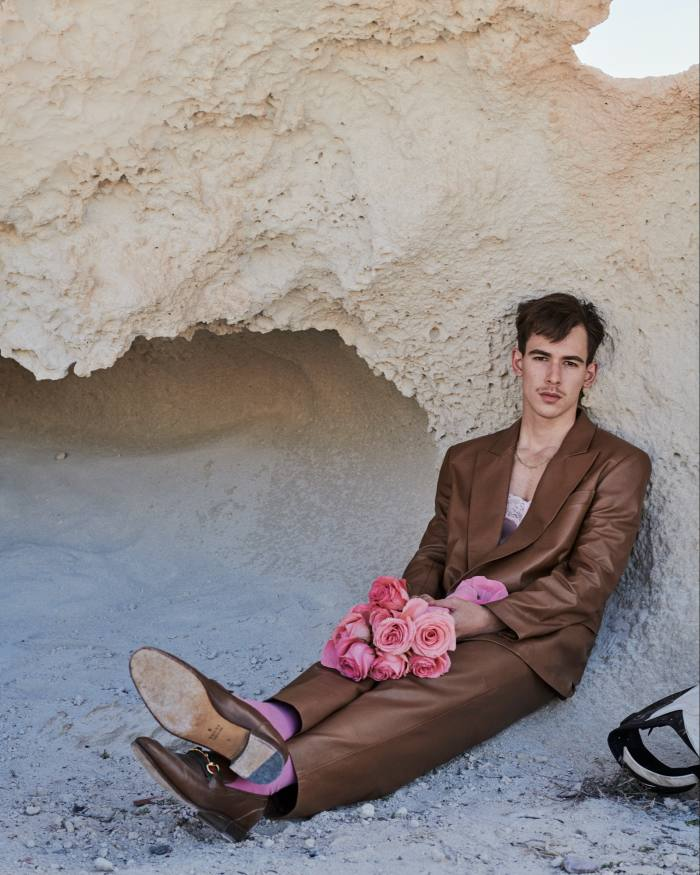 Gucci leather blazer, £3,430, matching trousers, £2,910, and leather moccasins, £610. Intimissimi silk top, £49. Falke wool and cotton Airport socks, £14. Necklace and earring, model's own