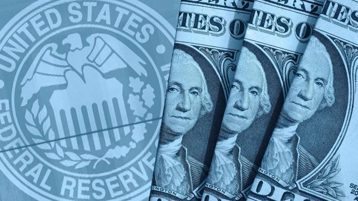 Montage combining the Federal Reserve seal with some US dollars