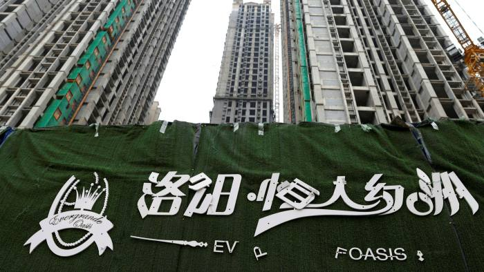 A peeling logo of Evergrande Oasis, an unfinished housing complex in Luoyang, China