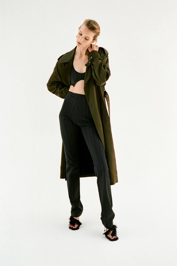 Saint Laurent by Anthony Vaccarello twill cotton trench,£2,080.Mukadi jersey bra, £72, and jersey trousers, £163. AcneStudios cotton/nylon fringe-heeled sandals, POA. Hannah Martin ebonyand gold Warrior earrings, £3,420