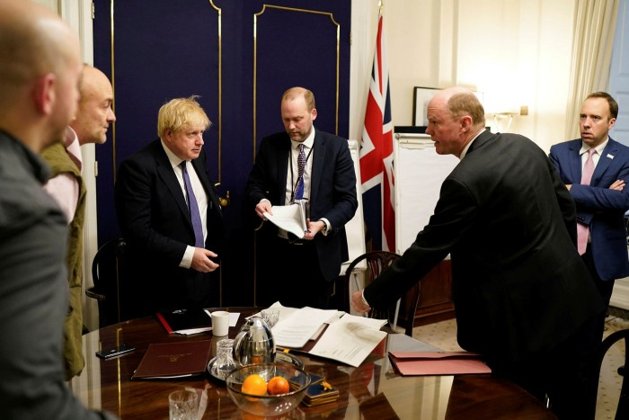 UK prime minister Boris Johnson (third from left) at a Downing Street meeting on February 28