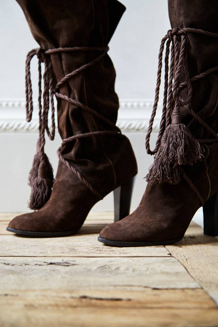 Her vintage 1970s Yves Saint Laurent suede boots