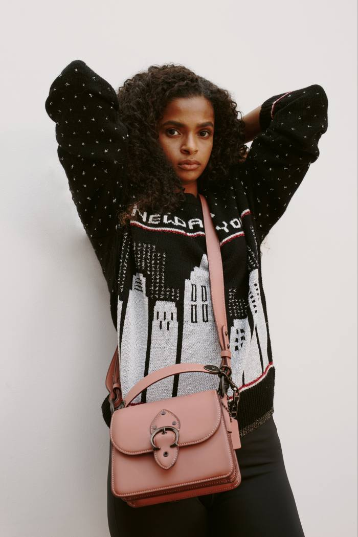 Coach wool/lurex-mix New York Skyline jumper, similar from £250, and leather Beat bag, £450. Nike recycled polyester Training sculpt leggings, £39.95. Hair, Nao Kawakami at The Wall Group, using Susanne Kaufmann. Make-up, Amy Wright at Caren Agency. Photographer's assistant, Francesco Zinno. Stylist's assistant, Bryony Hatrick. Production, MAD Productions