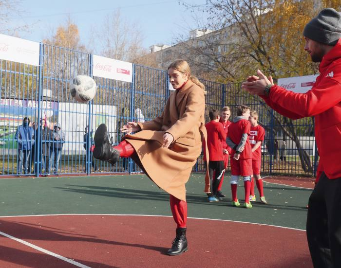 At aMoscow school, opening an inclusive playground created by her Naked Heart Foundation, 2019