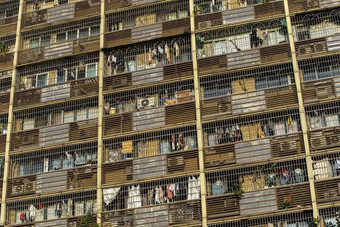 Laundry hangs out of windows at a residential building in Chongqing. While China's wealthier citizens have emerged largely unscathed financially from the pandemic, many on low incomes are struggling