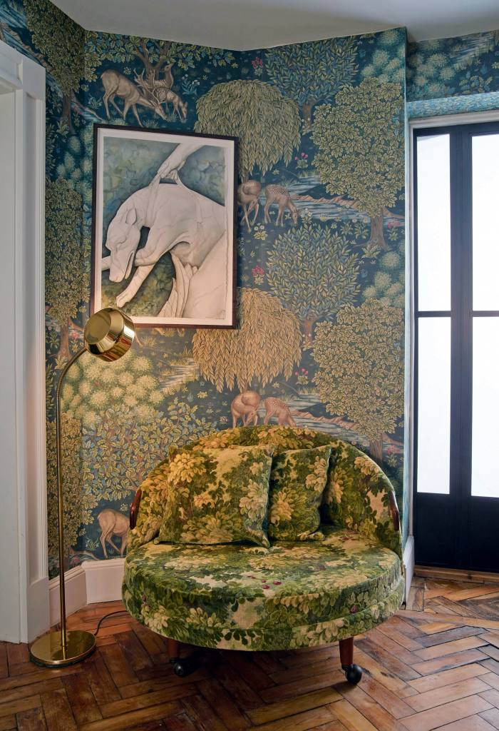 A love seat covered with verdure tapestry in a Bloomsbury home designed by Rachel Chudley