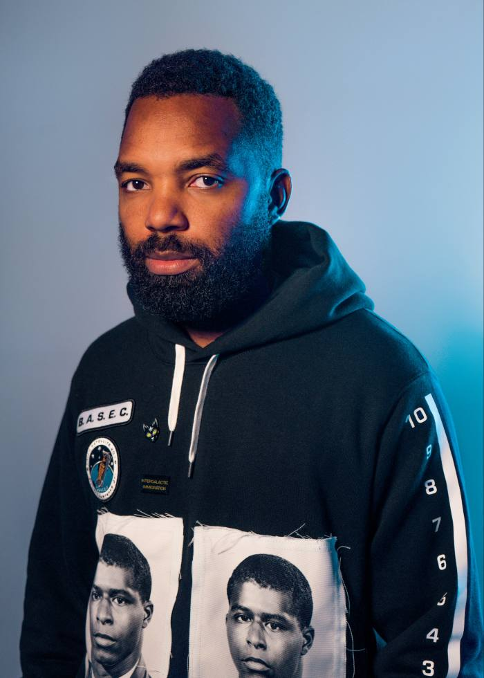 Tavares Strachan wearing the Robert Lawrence Jr Invisible hoodie he designed for his label, BASEC