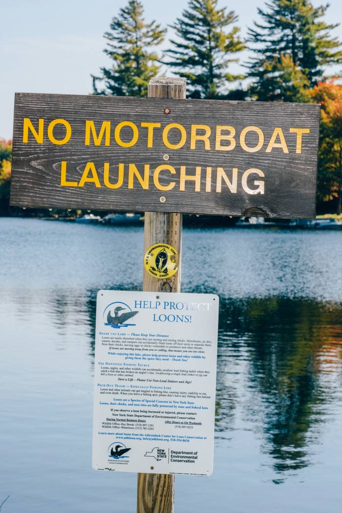 A sign beside the canoe launch on Sixth Lake