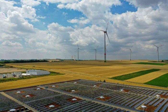 Solar panels near the hydrogen electrolysis plant at Energiepark Mainz in Germany, operated by Linde, left, in view of wind turbines. High costs and complexities have stunted previous efforts to create whole new economies centred around hydrogen