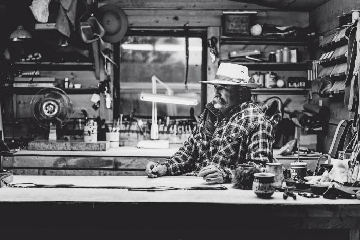 Ranchlands owner Duke Phillips III in the Chico Basin Ranch leather workshop