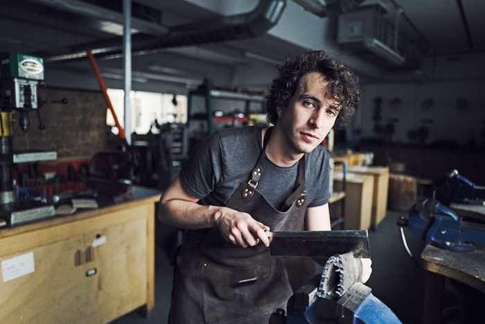 Alexander O'Neill sharpening one of his knives