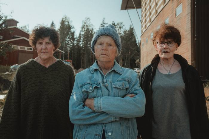 Three of the retired Finnish women who handknit pieces for Myssy