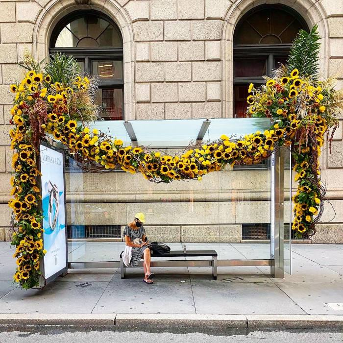 A bus shelter garlanded with sunflowers on 11September