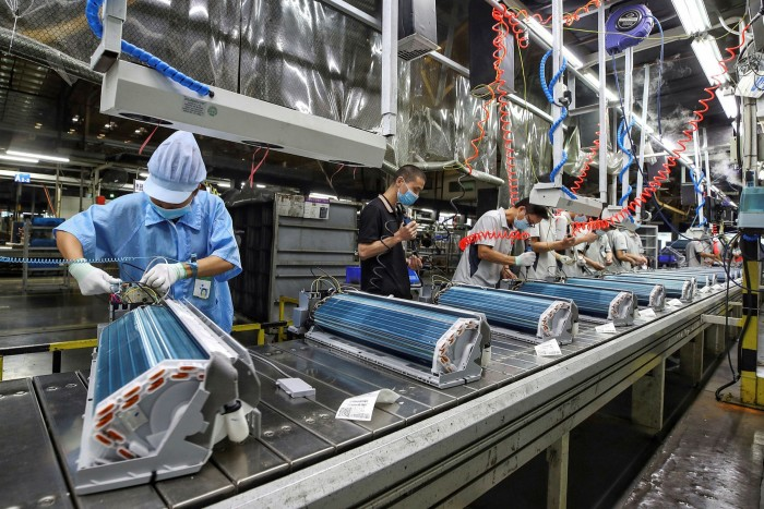 Haier employees work in Wuhan, China. Kevin Nolan of GE Appliances, owned by Haier, says: 'I saw other companies come out with big books of 'here is how you have to behave'. None of that happened here: it happened in real time on the ground'