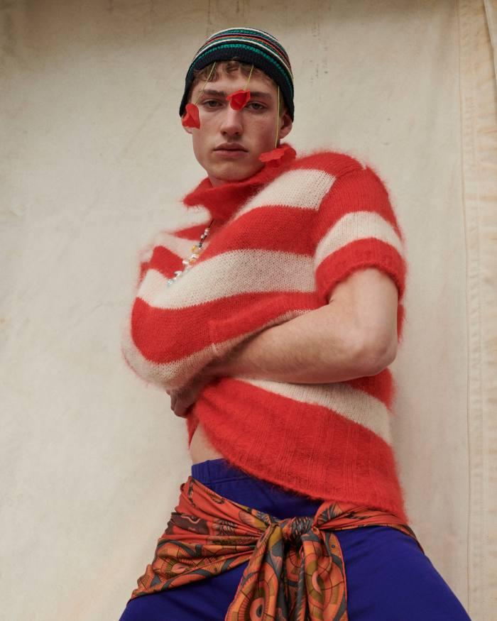Valentin wears Fendi wool jumper, POA. Phipps wool leggings, £170. Umit Benan cotton hat, £170. Panconesi pearl-dipped-in-enamel necklace, £325. Hermès silk twill scarf (seen around hips), £701
