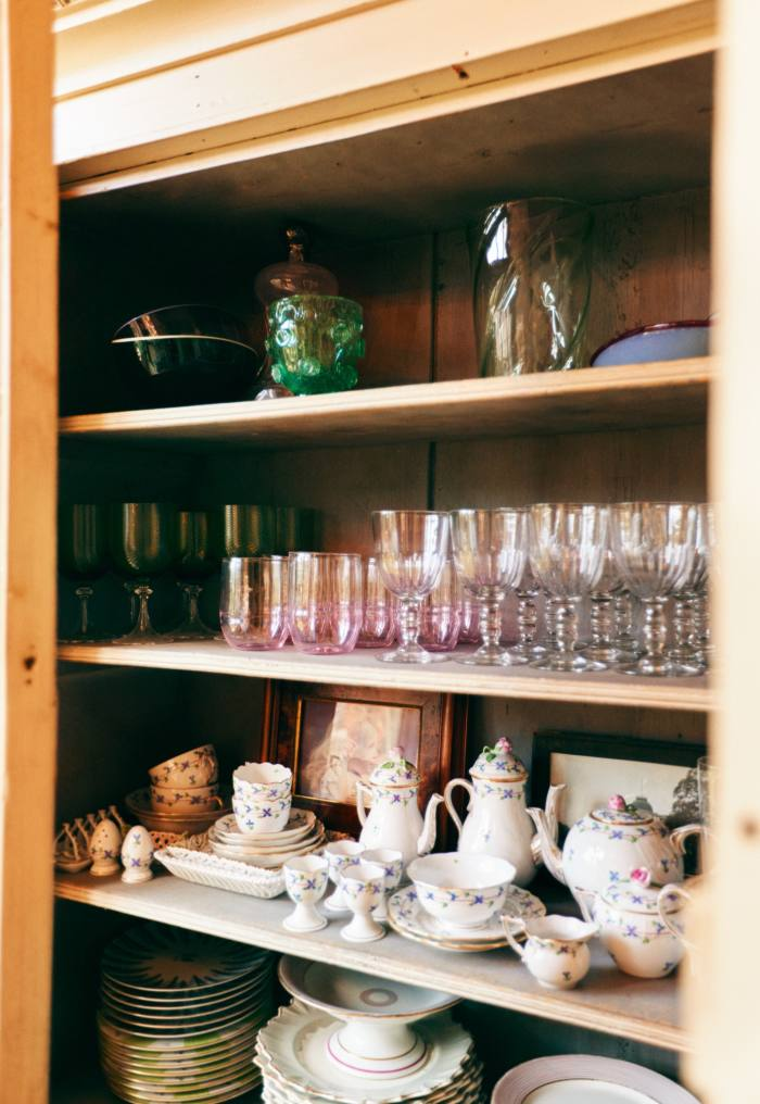 Her china cupboard, with glasses from Nason Moretti, The New Craftsmen, Guinevere Antiques...