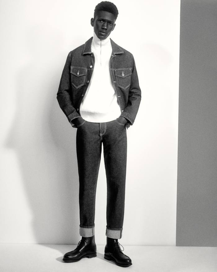 Moustapha Sy wears Guess x Friendswithyou cotton denim jacket, £115, and cotton denim trousers, £95. Louis Vuitton cashmere rollneck, £915. JM Weston leather Boxcalf Golf Montant boots, £790. Socks, model's own