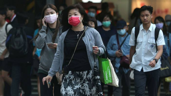 People wear face masks to help protect against the spread of the coronavirus in Taipei, Taiwan