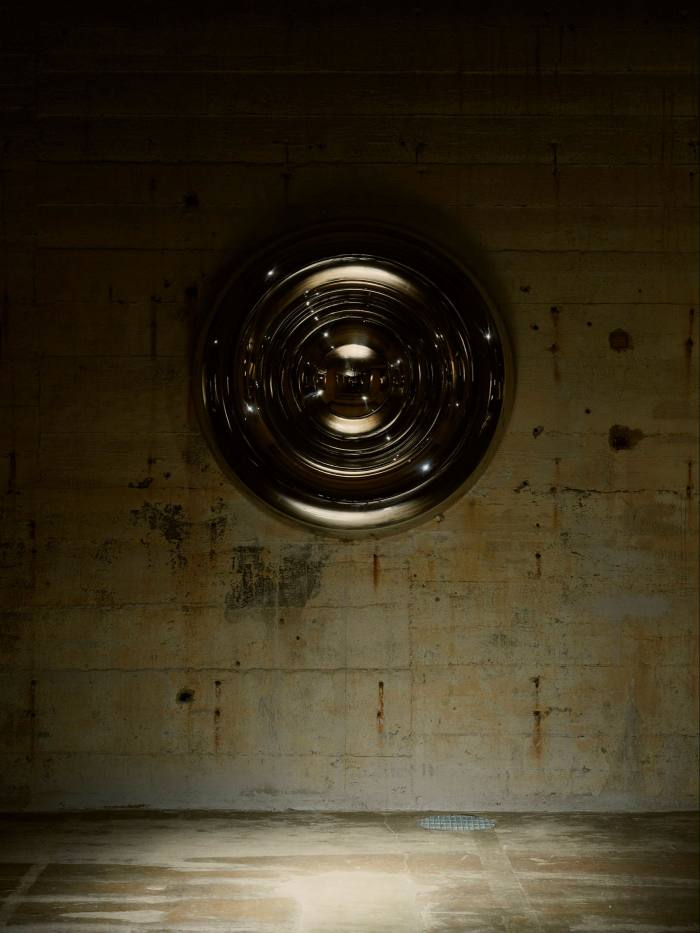 A steel circle on a wall